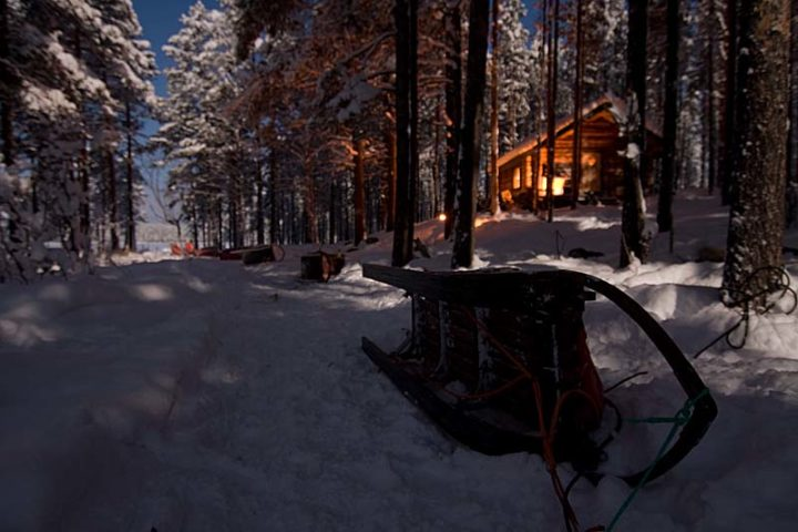 Block house in middle of the forest of Swedish Lapland. Moon light in middle of the night.