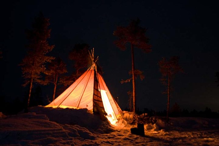 Traditional tent tipi with open fire inside.