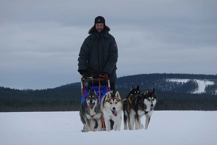 A happy Matthias and his husky team.
