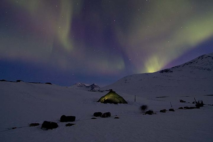 Northern lights in Ruotesvagge. The big tent is our base camp tent a Wigloo from Bergans.
