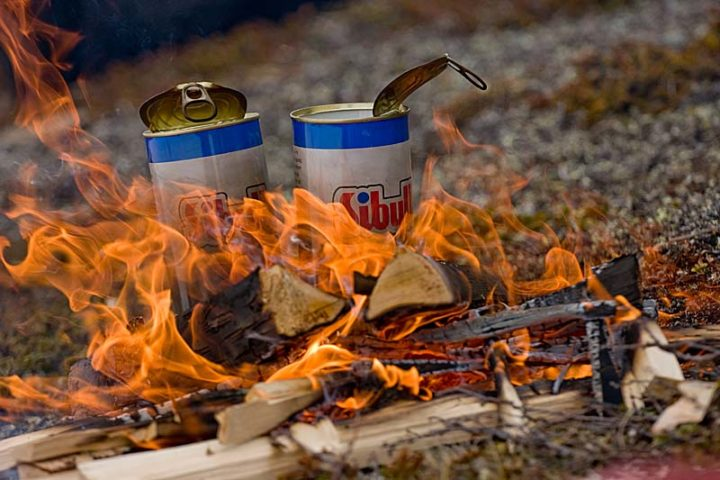 Fire and some hot dogs in a can.