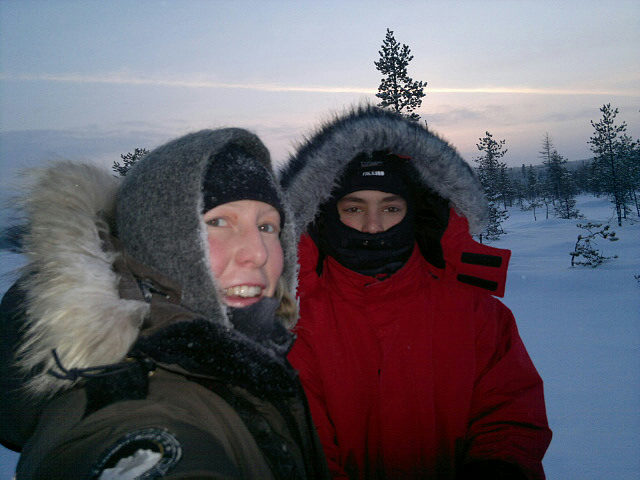 Stina and Lucas happy on their sled.