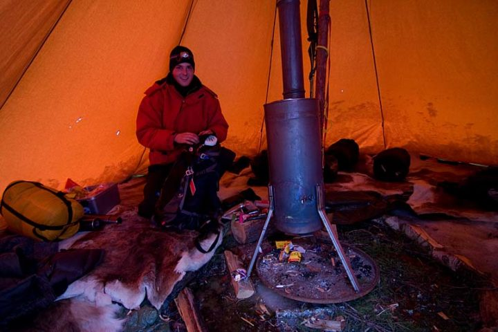 Alex inside our tipi tent with the hot stove.