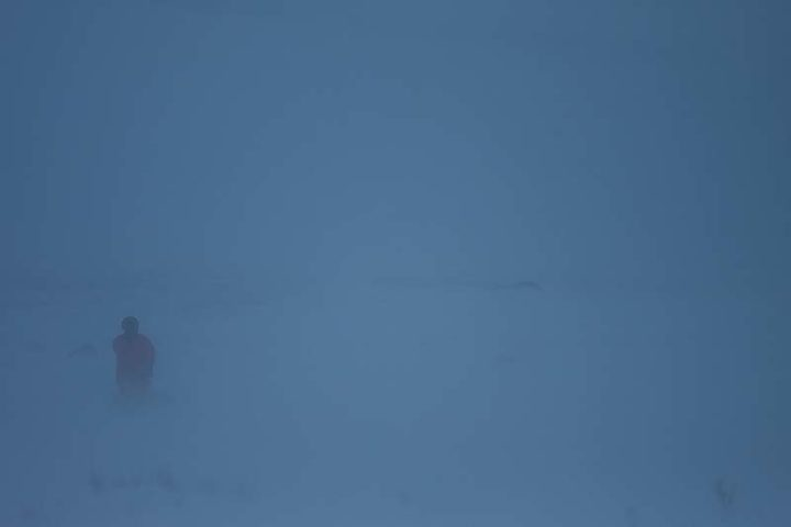 Snowstorm and dogsledding in Sarek National Park, Swedish Lapland.