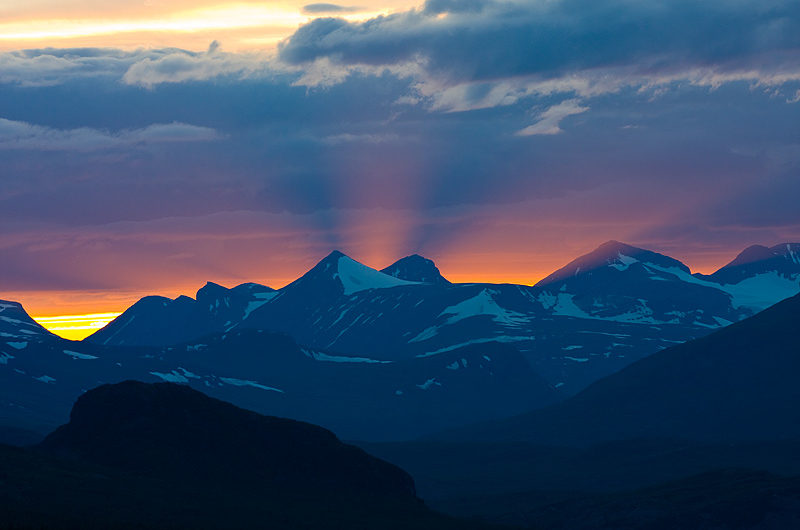 Sunset behinde the mountains of Sarek National Park.