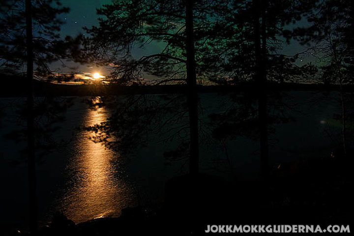 Moonlight and northern lights over lake Skabram