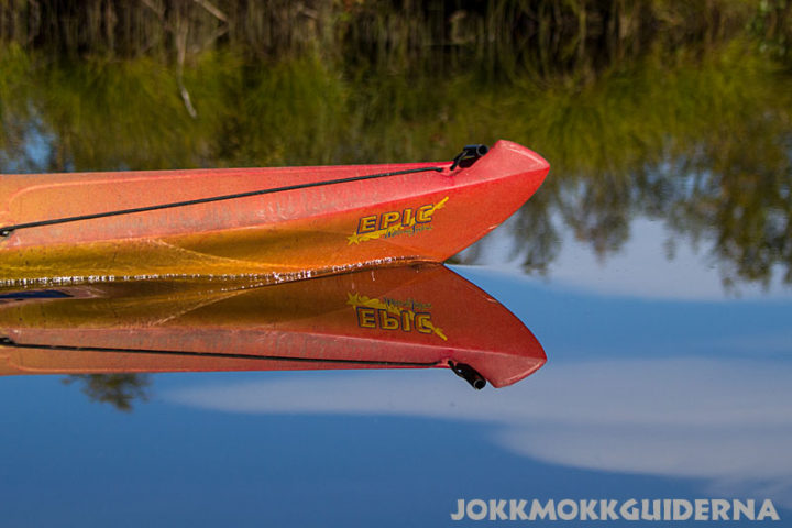 The kayak stem cleaves noiselessly the glassy surface. The delta of the river Appoälven, Jokkmokk.