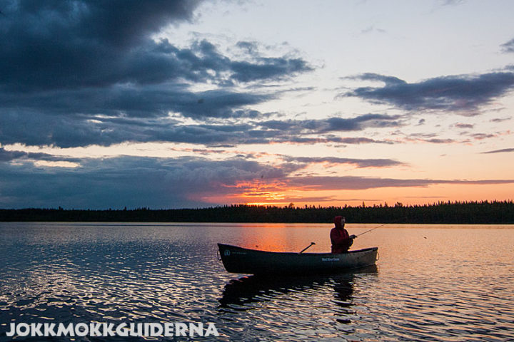 Fishing at night in a canadian canoe. Stina at lake Skabram.