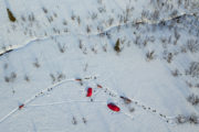 Air-photo over tent camp and dog teams on the tour: Sled dog adventure through Sjaunja and Kebnekaise