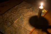 Mountain map reading candle light. Dog sled trip to the Gate of Sarek National Park