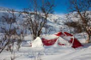 Snow covered hilleberg tent on the dog sled expedition Explore Sarek National Park.