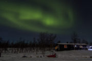 Northern lights Aurora Borealis in Sitojaure Swedish Mountains. On the dog sled adventure A Taste of Sarek.