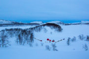 Dog sleds and tents between hills at the tour A Taste of Sarek National Park