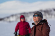 Happy guest on the dog sled adventure A Taste of Sarek National Park
