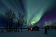 Aurora Borealis northern lights over mountain hut in Sitojaure. Dog sled advdenture A Taste of Sarek National Park