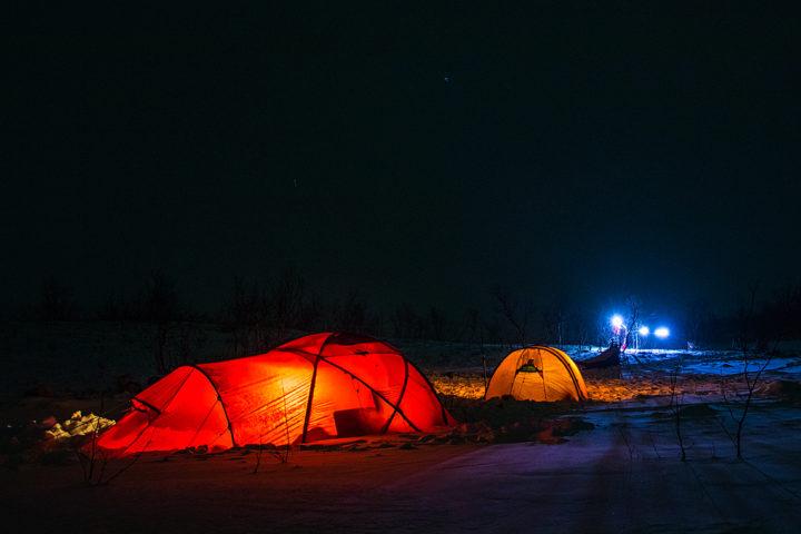illuminated Hileberg tents on the dog sled adventure called A Taste of Sarek National Park