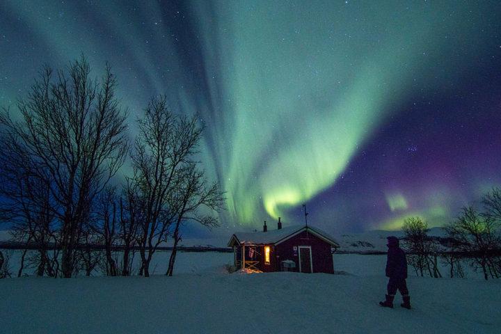 Northern lights Aurora over Sitojaure cabin, Swedish Lapland.