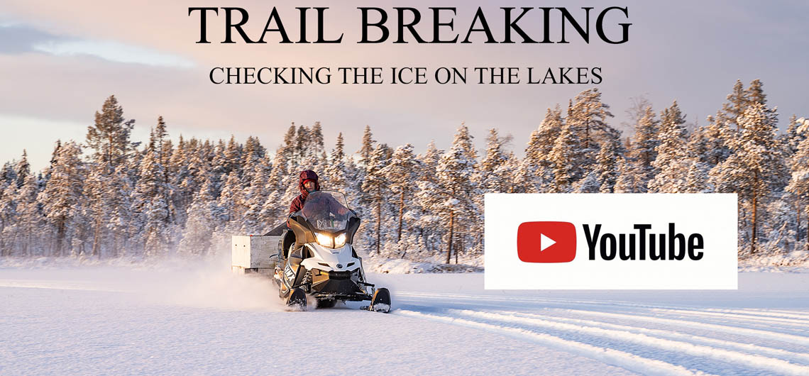 trail breaking with snowmobile and checking the ice on the lakes